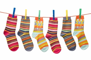 child clothesline with socks, isolated on white background